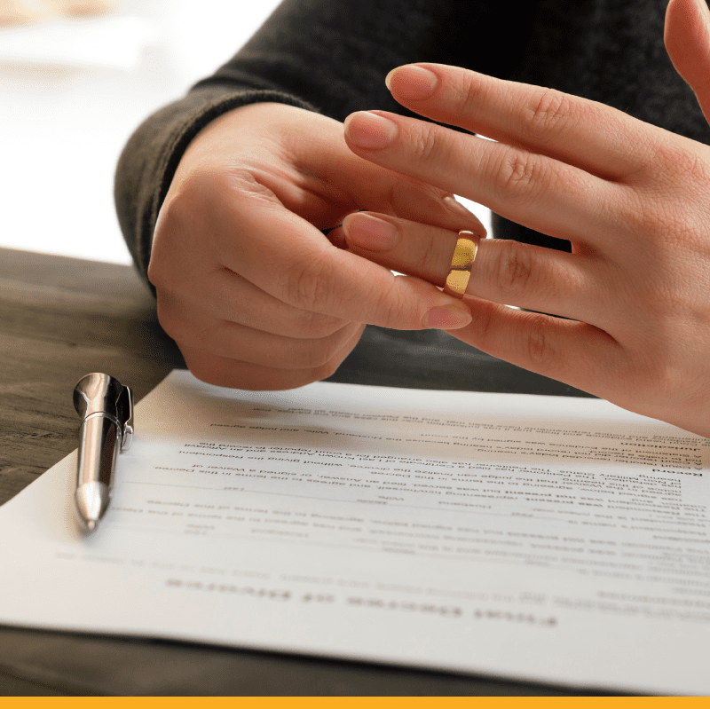 signing-divorce-papers-removing-ring